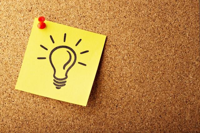 idea sticky note on board - Ledgersonline