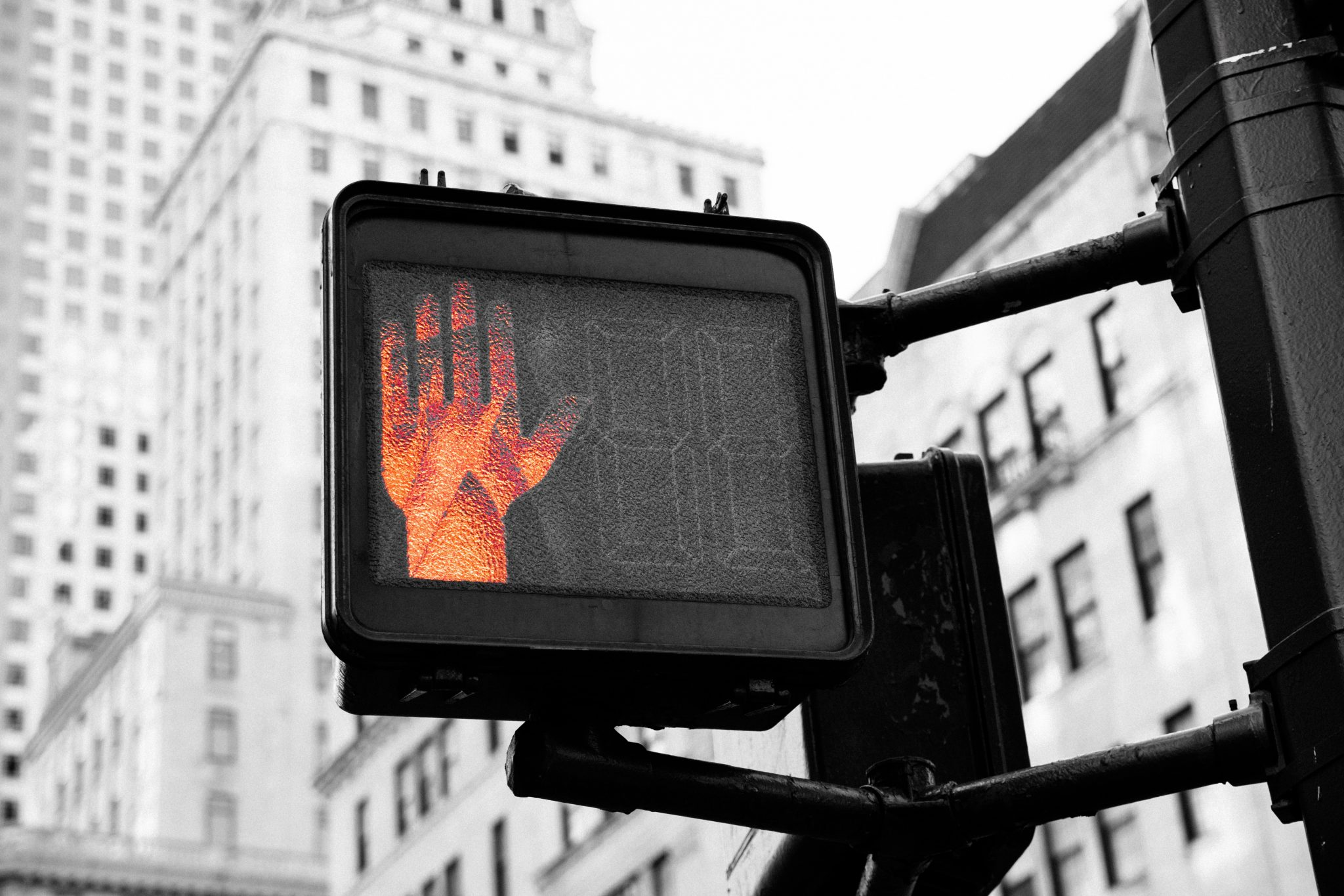 stop street sign with hand - Ledgersonline